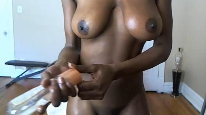 Oil on her ebony tits